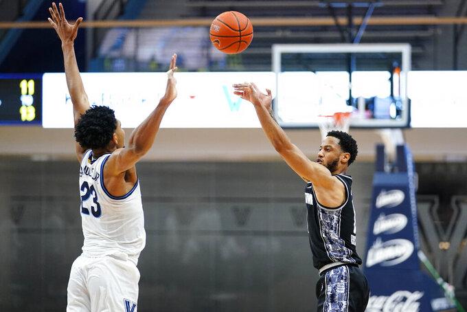 Georgetown's Jahvon Blair, right, goes up for a shot against Villanova's Jermaine Samuels during the second half of an NCAA college basketball game, Sunday, Feb. 7, 2021, in Villanova, Pa. (AP Photo/Matt Slocum)