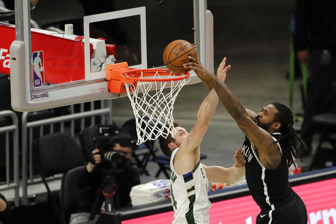 Brooklyn Nets' DeAndre Jordan is fouled by Milwaukee Bucks' Pat Connaughton as he attempts a shot during the first half of an NBA basketball game Tuesday, May 4, 2021, in Milwaukee. (AP Photo/Aaron Gash)
