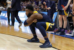 UC Irvine guard Max Hazzard celebrates during the second half of a first round men's college basketball game against Kansas State in the NCAA Tournament, Friday, March 22, 2019, in San Jose, Calif. (AP Photo/Chris Carlson)