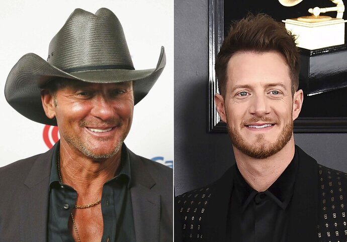 "This combination photo shows Tim McGraw at the iHeartCountry Festival in Austin, Texas on May 4, 2019, left, and Tyler Hubbard of the duo Florida Georgia Line at the 61st annual Grammy Awards in Los Angeles on Feb. 10, 2019. Hubbard and McGraw are asking people to walk a mile in someone else's shoes in a call for unity on their new duet ""Undivided."