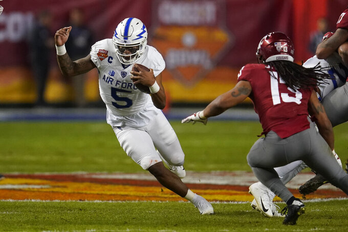 Air Force quarterback Donald Hammond III (5) runs for a first down against Washington State during the first half during the Cheez-It Bowl NCAA college football game, Friday, Dec. 27, 2019, in Phoenix. (AP Photo/Rick Scuteri)