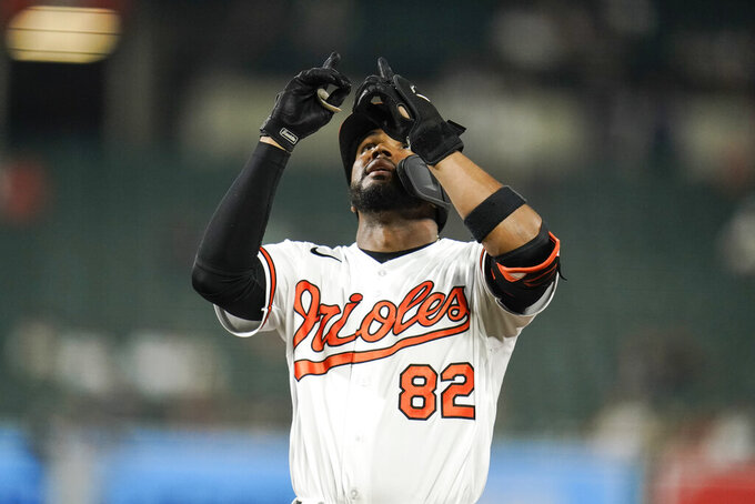 Baltimore Orioles' Kelvin Gutierrez gestures after hitittng an RBI single to score Austin Wynns during the ninth inning of a baseball game against the New York Yankees, Tuesday, Sept. 14, 2021, in Baltimore. (AP Photo/Julio Cortez)