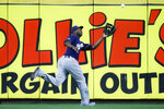 Milwaukee Brewers' Lorenzo Cain catches a fly ball hit by Cincinnati Reds' Phillip Ervin to close the seventh inning of a baseball game, Tuesday, Sept. 24, 2019, in Cincinnati. (AP Photo/John Minchillo)