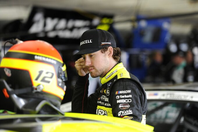 Ryan Blaney waits during practice for Sunday's NASCAR Cup Series auto race at Charlotte Motor Speedway in Concord, N.C., Saturday, Sept. 28, 2019. (AP Photo/Mike McCarn)