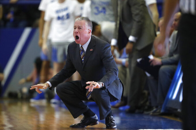 Air Force head coach Dave Pilipovich directs his team against San Diego State in the second half of an NCAA college basketball game Saturday, Feb. 8, 2020, at Air Force Academy, Colo. (AP Photo/David Zalubowski)