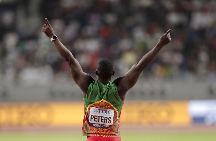Anderson Peters, of Grenada reacts on his way to winning the gold medal in the men's javelin throw final at the World Athletics Championships in Doha, Qatar, Sunday, Oct. 6, 2019. (AP Photo/Nariman El-Mofty)