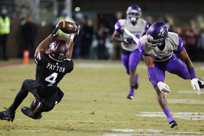 Mississippi State wide receiver JaVonta Payton (4) catches a batted pass reception between him and Abilene Christian cornerback Adonis Davis, right, during the second half of an NCAA college football game, Saturday, Nov. 23, 2019, in Starkville, Miss. Mississippi State won 45-7. (AP Photo/Rogelio V. Solis)