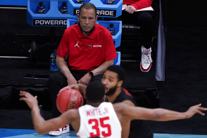 Houston head coach Kelvin Sampson watches action against Oregon State during the first half of an Elite 8 game in the NCAA men's college basketball tournament at Lucas Oil Stadium, Monday, March 29, 2021, in Indianapolis. (AP Photo/Darron Cummings)