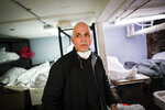 Pat Marmo, owner of Daniel J. Schaefer Funeral Home, walks through his body holding facility that is struggling to handle overflow of clients stemming from COVID-19 deaths, Thursday, April 2, 2020, in the Brooklyn borough of New York.