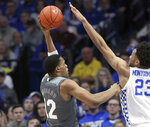 Mississippi State's Robert Woodard, left, shoots while defended by Kentucky's EJ Montgomery (23) during the first half of an NCAA college basketball game in Lexington, Ky., Tuesday, Jan. 22, 2019. (AP Photo/James Crisp)