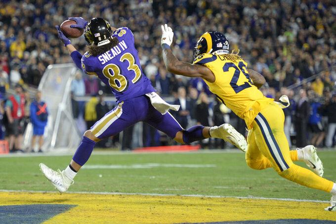 Baltimore Ravens wide receiver Willie Snead catches a touchdown pass in front of Los Angeles Rams defensive back Marqui Christian during the first half of an NFL football game Monday, Nov. 25, 2019, in Los Angeles. (AP Photo/Kyusung Gong)