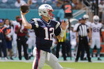 New England Patriots quarterback Tom Brady (12) looks to pass, during the first half at an NFL football game against the Miami Dolphins, Sunday, Sept. 15, 2019, in Miami Gardens, Fla. (AP Photo/Lynne Sladky)