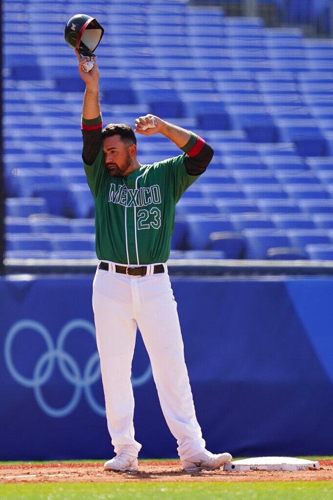 Mexico's Adrian Gonzalez wipes his face during a baseball game against Israel at Yokohama Baseball Stadium during the 2020 Summer Olympics, Sunday, Aug. 1, 2021, in Yokohama, Japan. (AP Photo/Matt Slocum)