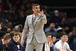 FILE - Villanova head coach Jay Wright gestures during the first half of an NCAA college basketball game against Georgetown in Washington, in this Saturday, March 7, 2020, file photo. Villanova coach Jay Wright was set to return to practice Tuesday following his bout with COVID-19. Those plans are on hold after two players tested positive Monday, Jan. 4, 2021, and the Wildcats were forced to postpone their next three games. (AP Photo/Nick Wass, File)