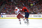 Washington Capitals left wing Alex Ovechkin (8), of Russia, collides with Carolina Hurricanes defenseman Justin Faulk (27) during the first period of Game 5 of an NHL hockey first-round playoff series, Saturday, April 20, 2019, in Washington. (AP Photo/Nick Wass)