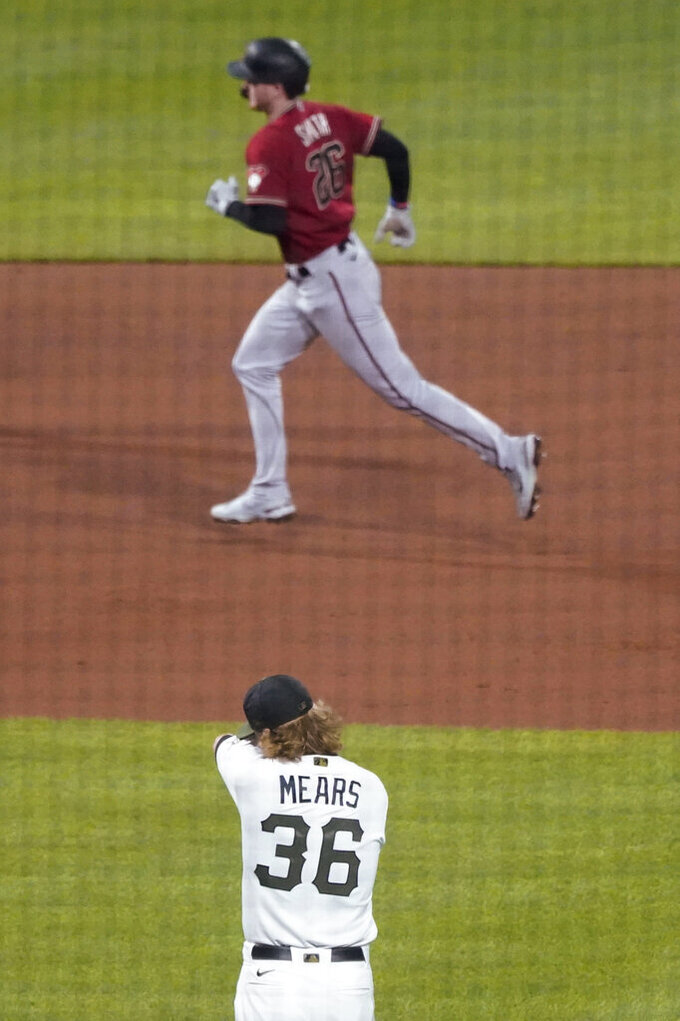 Pittsburgh Pirates relief pitcher Nick Mears (36) wipes his face as Arizona Diamondbacks' Pavin Smith runs the bases on a solo home run during the sixth inning of a baseball game Wednesday, Aug. 25, 2021, in Pittsburgh. (AP Photo/Keith Srakocic)
