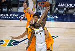 New Orleans Pelicans forward Zion Williamson (1) lays the ball up as Utah Jazz center Rudy Gobert, left, and others defend during the first half of an NBA basketball game Tuesday, Jan. 19, 2021, in Salt Lake City. (AP Photo/Rick Bowmer)
