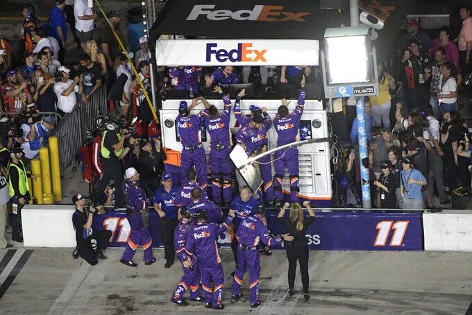 Crew members celebrate on pit road after Denny Hamlin won a NASCAR Daytona 500 auto race at Daytona International Speedway, Sunday, Feb. 17, 2019, in Daytona Beach, Fla. (AP Photo/Phelan M. Ebenhack)
