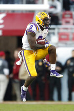 LSU linebacker Patrick Queen (8) reacts after intercepting a pass in the first half of an NCAA college football game against Alabama, Saturday, Nov. 9, 2019, in Tuscaloosa, Ala. (AP Photo/John Bazemore)