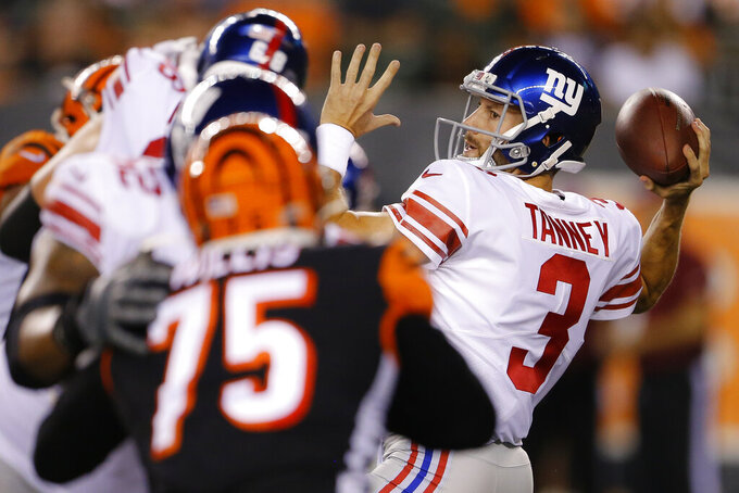 New York Giants quarterback Alex Tanney (3) passes the ball during the second half of the team's NFL preseason football game against the Cincinnati Bengals, Thursday, Aug. 22, 2019, in Cincinnati. (AP Photo/Gary Landers)