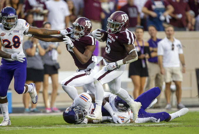 Texas A&M running back Trayveon Williams (5) breaks free from a Northwestern State defender on his way to a 73-yard touchdown run during the first half of an NCAA college football game Thursday, Aug. 30, 2018, in College Station, Texas. (AP Photo/Sam Craft)