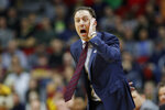 Minnesota head coach Richard Pitino directs his team during a first round men's college basketball game against Louisville in the NCAA Tournament, Thursday, March 21, 2019, in Des Moines, Iowa. (AP Photo/Charlie Neibergall)