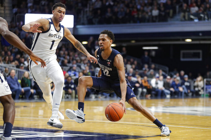 Georgetown guard Terrell Allen (12) drives on Butler forward Jordan Tucker (1) in the second half of an NCAA college basketball game in Indianapolis, Saturday, Feb. 15, 2020. Georgetown defeated Butler 73-66. (AP Photo/Michael Conroy)