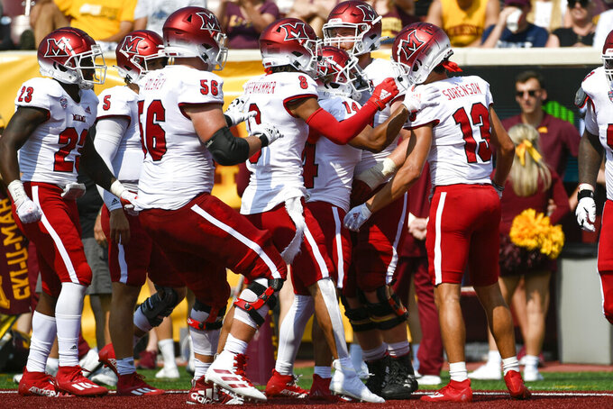 Miami-Ohio Wide Receiver Jack Sorenson (13) celebrates with his teammates after catching a 23-yard pass for a touchdown during the second half of an NCAA college football game against Minnesota, Saturday, Sept. 11, 2021, in Minneapolis. Minnesota won 31-26. (AP Photo/Craig Lassig)
