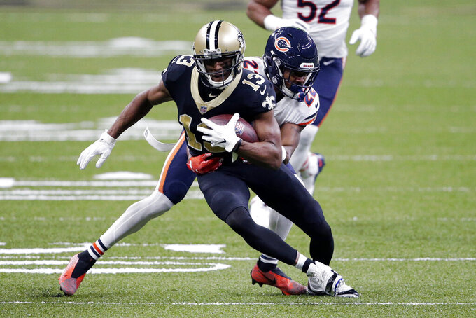 New Orleans Saints wide receiver Michael Thomas (13) carries against Chicago Bears cornerback Kindle Vildor (22) in the first half of an NFL wild-card playoff football game in New Orleans, Sunday, Jan. 10, 2021. (AP Photo/Butch Dill)