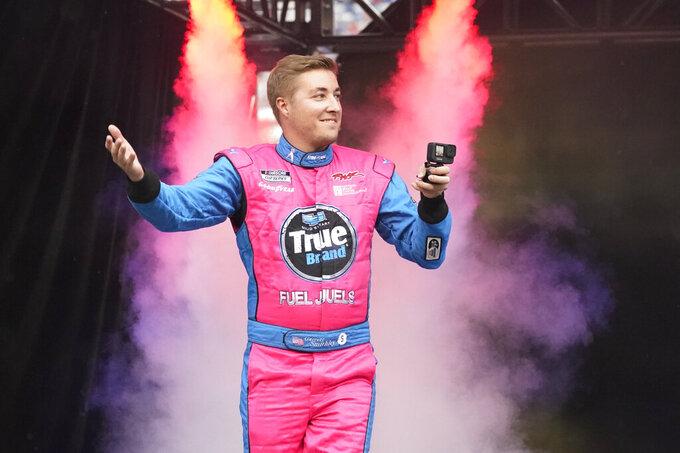 Garrett Smithley waves to fans before a NASCAR Cup Series auto race at Bristol Motor Speedway Saturday, Sept. 18, 2021, in Bristol, Tenn. (AP Photo/Mark Humphrey)