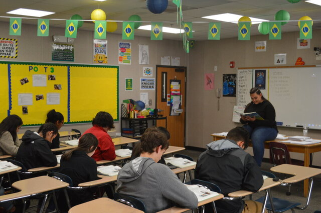 In this Dec. 12, 2019, photo Stephany Zuniga teaches Portuguese at Johnson High School in Hall County, Ga. (Kelsey Podo/The Times via AP)