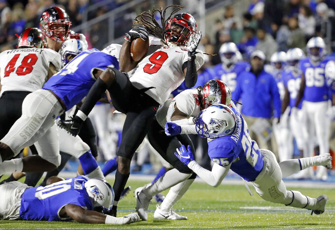 Western Kentucky wide receiver Xavier Lane (9) is brought down in the first half of an NCAA college football game against Middle Tennessee Friday, Nov. 2, 2018, in Murfreesboro, Tenn. (AP Photo/Mark Humphrey)