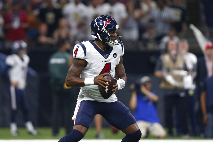 Houston Texans quarterback Deshaun Watson (4) passes in the first half of an NFL football game against the New Orleans Saints in New Orleans, Monday, Sept. 9, 2019. (AP Photo/Gerald Herbert)
