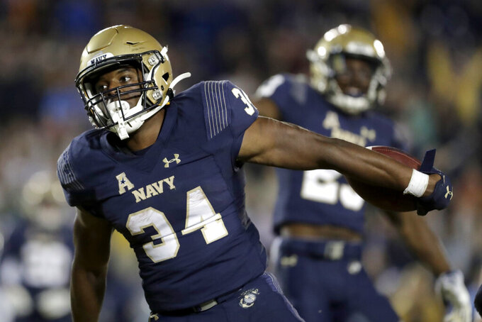 Navy fullback Jamale Carothers celebrates after scoring a touchdown on a run against Tulane during the second half of an NCAA college football game, Saturday, Oct. 26, 2019, in Annapolis. Navy won 41-38. (AP Photo/Julio Cortez)