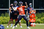 Chicago Bears quarterback Andy Dalton looks to pass during NFL football practice in Lake Forest, Ill., Wednesday, June 2, 2021. (AP Photo/Nam Y. Huh)