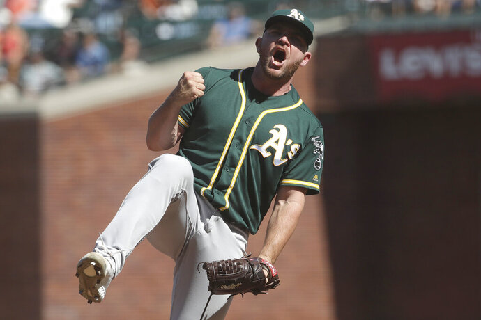 Oakland Athletics pitcher Liam Hendriks celebrates after striking out San Francisco Giants' Brandon Belt for the final out of a baseball game in San Francisco, Wednesday, Aug. 14, 2019. The A's won 9-5.(AP Photo/Jeff Chiu)