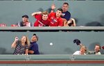 Fans watch out as a home run drive by Kansas City Royals' Jorge Soler bounces over their heads during the sixth inning of a baseball game against the Boston Red Sox at Fenway Park in Boston, Tuesday, Aug. 6, 2019. (AP Photo/Charles Krupa)