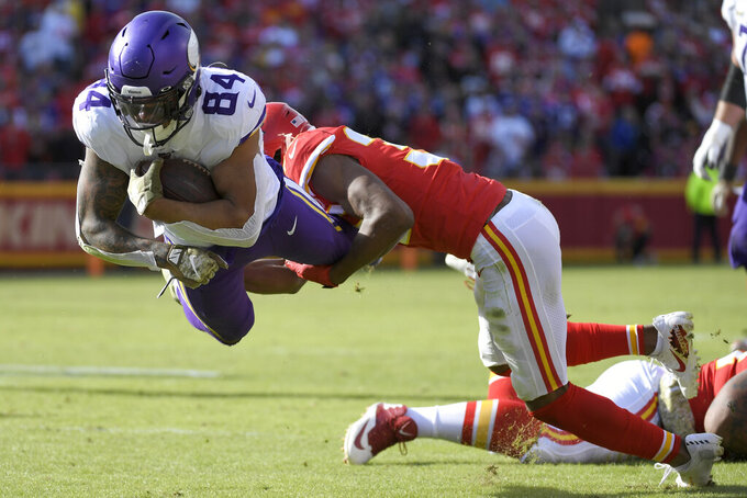 Minnesota Vikings tight end Irv Smith Jr. (84) is tackled by Kansas City Chiefs cornerback Charvarius Ward (35) during the second half of an NFL football game against the Kansas City Chiefs in Kansas City, Mo., Sunday, Nov. 3, 2019. (AP Photo/Reed Hoffmann)