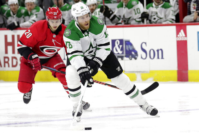 FILE - In this Tuesday, Feb. 25, 2020 file photo, Dallas Stars' Joe Pavelski (16) drives against Carolina Hurricanes' Sebastian Aho (20) during the first period of an NHL hockey game in Raleigh, N.C. The Dallas Stars were in a miserable stretch when the NHL season came to a sudden and unexpected stop 4 1/2 months ago. Vegas was playing some of its best hockey after a coaching change. Both now have the same chance of being the No. 1 seed in the Western Conference playoffs, and a better chance to re-acclimate to playing again than having to jump right into a playoff series for the resumption of this unprecedented season because of the coronavirus (AP Photo/Chris Seward, File)