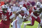 Alabama's Najee Harris rushes past South Carolina's Zacch Pickens for a first down during the first half of an NCAA college football game Saturday, Sept. 14, 2019, in Columbia, S.C. (AP Photo/Richard Shiro)