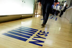 FILE- In this April 5, 2018, file photo a NYSE logo adorns the entrance to the trading floor the New York Stock Exchange. The U.S. stock market opens at 9:30 a.m. EDT on Thursday, Oct. 11. (AP Photo/Richard Drew, File)