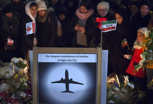 Mourners attend a memorial, Tuesday, Jan. 14, 2020, in North Vancouver, British Columbia, to remember Canadian victims in the deadly downing of a Ukrainian airliner the week before, in Iran. (Jonathan Hayward/The Canadian Press via AP)