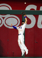 Kansas City Royals left fielder Alex Gordon catches a fly ball hit by Chicago White Sox James McCann during the seventh inning of a baseball game at Kauffman Stadium in Kansas City, Mo., Tuesday, July 16, 2019. (AP Photo/Orlin Wagner)