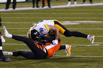 Cincinnati Bengals quarterback Ryan Finley (5) is sacked by Pittsburgh Steelers' T.J. Watt (90) during the first half of an NFL football game, Monday, Dec. 21, 2020, in Cincinnati. (AP Photo/Bryan Woolston)