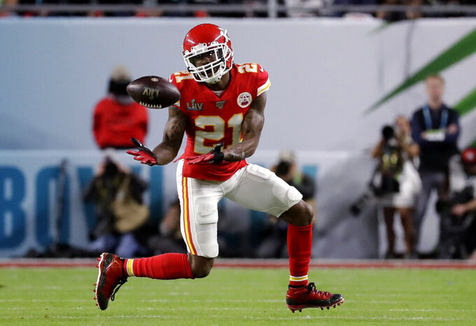 FILE - In this Feb. 2, 2020, file photo, Kansas City Chiefs' Bashaud Breeland (21) intercepts a San Francisco 49ers pass during the first half of NFL football's Super Bowl 54 in Miami Gardens, Fla. Breeland was arrested on several charges Tuesday, April 28, in South Carolina, including possessing marijuana or hash, driving with an open container of alcohol and resisting arrest. The 28-year-old Breeland, of Charlotte, N.C., was being held at the York County Jail, according to the facility's online records. (AP Photo/Wilfredo Lee, File)