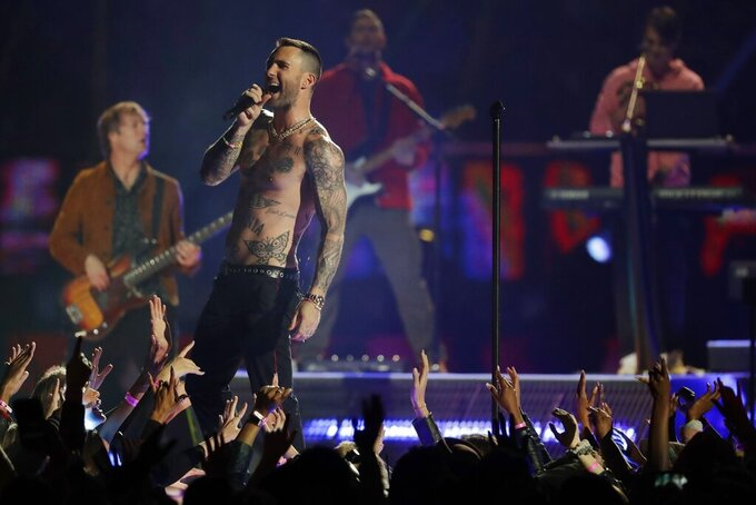 Adam Levine of Maroon 5 performs during halftime of the NFL Super Bowl 53 football game between the Los Angeles Rams and the New England Patriots Sunday, Feb. 3, 2019, in Atlanta. (AP Photo/Jeff Roberson)
