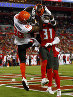 Tampa Bay Buccaneers free safety Jordan Whitehead (31) breaks up a pass intended for Cleveland Browns tight end Demetrius Harris (88) during the first half of an NFL preseason football game Friday, Aug. 23, 2019, in Tampa, Fla. (AP Photo/Mark LoMoglio)