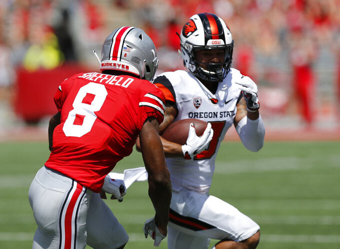 Oregon State wide receiver Trevon Bradford, right, tries to outrun Ohio State defensive back Kendall Sheffield during the first half of an NCAA college football game Saturday, Sept. 1, 2018, in Columbus, Ohio. (AP Photo/Jay LaPrete)