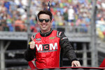 FILE - In this Sunday, Feb. 16, 2020, file photo, Timmy Hill takes a parade lap in front of fans before the NASCAR Daytona 500 auto race at Daytona International Speedway in Daytona Beach, Fla. Virtual racing has been the small saving grace for motorsports since the coronavirus global pandemic brought nearly everything to a halt. For journeyman driver Timmy Hill, his iRacing victory on national television gave Hill and his sponsors exposure they'd never receive during a normal NASCAR weekend. (AP Photo/John Raoux, File)