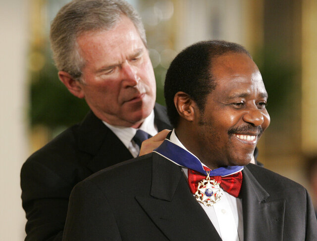 FILE - In this Wednesday, Nov. 9, 2005 file photo, President Bush awards Paul Rusesabagina, who sheltered people at a hotel he managed during the 1994 Rwandan genocide, the Presidential Medal of Freedom Award in the East Room of the White House, in Washington. Rusesabagina, who was portrayed in the film